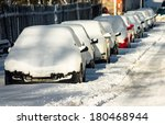 Line Of Snow Covered Cars.