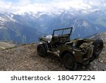 Military Jeep At The Summit Of...