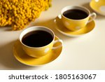Two Yellow Coffee Cups On Whit...