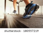man running in a gym on a... | Shutterstock . vector #180557219