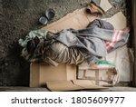 Old Homeless Man Wearing...