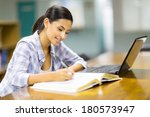 pretty college student studying ... | Shutterstock . vector #180573947