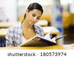 young college girl reading a... | Shutterstock . vector #180573974