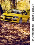 Small photo of Santander, Cantabria / Spain, 11-18-2018: Mitsubishi Lancer Evolution 9, shot in a mountain road full of autumn leaves