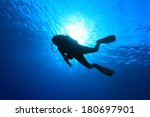 silhouette of scuba diver and...