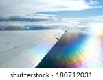 wing of airplane flying above... | Shutterstock . vector #180712031