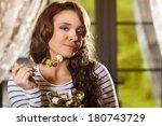pretty woman eating fresh... | Shutterstock . vector #180743729