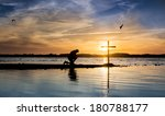 Cross At A Lake With A Man In...