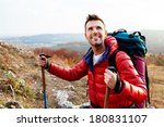 Smiling Hiker Holding Poles An...
