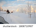 A Winter Ride On A Snowmobiles  ...