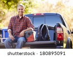 portrait of man sitting in pick ... | Shutterstock . vector #180895091