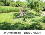 A Side View Of An Antique Hay...