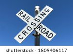 A Railroad Crossing Sign In...
