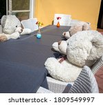 A Group Of Teddy Bears Sitting...