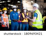 Small photo of The manager or leader team is assignmenting a job for team of technicians, supervisor, foreman and engineers In the morning meeting before work In which everyone wear masks to prevent the coronavirus