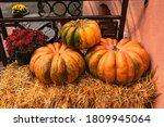 Three Large Orange Pumpkins And ...
