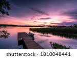 Sunset lake pier landscape. Lake pier at sunset. Sunset lake pier boat. Boat at sunset lake pier