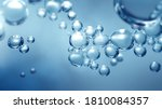 Small photo of Bubbling fizz and refreshing beauty care products cleanliness or reviving vitality. Studio shot of transparent effervescent blue gas bubbles levitating in macroscopic view with defocus bokeh blur.