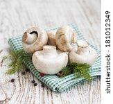 Champignon Mushrooms  On A Old...