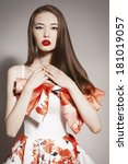 Small photo of languishing look young beautiful asian brunette in gorgeous dress. posing at camera