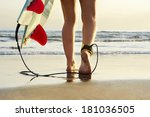 young surfer girl walking to... | Shutterstock . vector #181036505