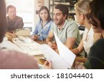 six architects sitting around... | Shutterstock . vector #181044401
