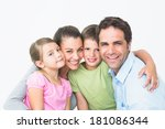 cute family smiling at camera...   Shutterstock . vector #181086344