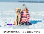 Girl Sitting Next To Dog