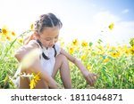Girl Playing In The Sunflower...