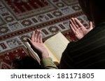 muslim man is reading the koran | Shutterstock . vector #181171805