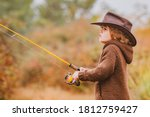 Little angler fishing on lake. Family and generation - autumn holidays and people concept