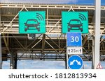 Small photo of automatic point of payment on a toll road. turnpike.area pay tolls on the toll road.Urban highway.speed limit, board sign of automatic paying lanes, non-stop driving symbol.