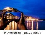 Tourist Taking Photo Of...