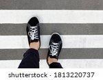 Feet In Sneakers On A...