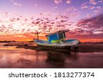 Boat On The Beach At Sunset...