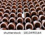 Rows Of Earthen Colored Cerami...