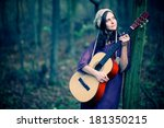 Girl With A Guitar In The...