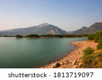 Scenic Dillon reservoir in Frisco, Colorado. Mountains rise above clear blue water