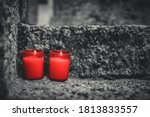 Two Red Candles On A Grave....