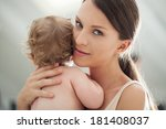 smiling mother holding her cute ... | Shutterstock . vector #181408037