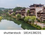 Traditional Houses And A River...