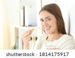 Happy Woman Holding A Vitamin...