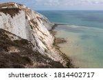 White Chalk Cliffs And Ocean...