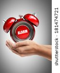 Small photo of Man hand holding object ( alarm bell ) High resolution