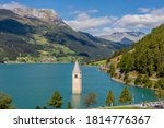 Beautiful aerial view of Lake Resia and submerged bell tower, Curon (Graun) Venosta, South Tyrol, Italy