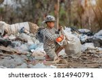 Small photo of Child labor. Children are forced to work on rubbish. Poor children collect garbage. Poverty, Violence children and trafficking concept,Anti-child labor, Rights Day on December 10.