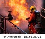 Firefighter Using Water Fog...