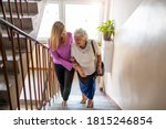 Caregiver Helping Senior Woman...