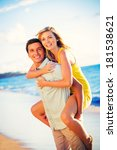 happy couple on the beach at... | Shutterstock . vector #181538621