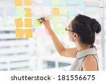 smiling designer writing on... | Shutterstock . vector #181556675